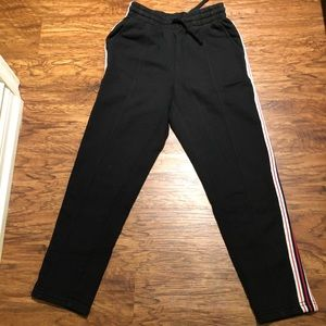 Track pants with strip down the side